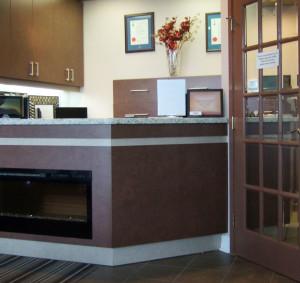 Dental office reception area including fireplace